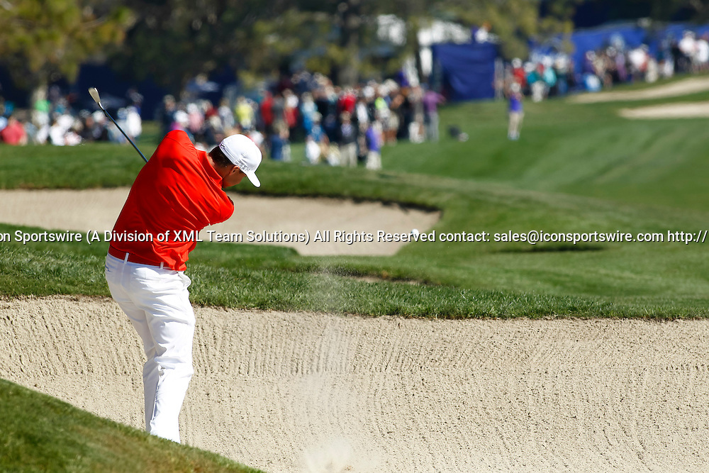 February 7, 2015:  Nick Watney hits from a bunker on the left side of the 6th hole on the Torrey Pines Golf Course during the third round of the Farmers Insurance Open in San Diego, Ca.