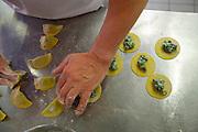"South Tyrol. Toblach/Kandellen (Dobbiaco/Gandelle). Seiterhof restaurant and hotel. Owner and Chef Herbert Kamelger preparing traditional ""Schlutzkrapfen"" (dumplings filled with cheese and herbs)."