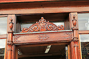 Wood carving building detail in historic Hanseatic League wooden buildings Bryggen area, Bergen, Norway