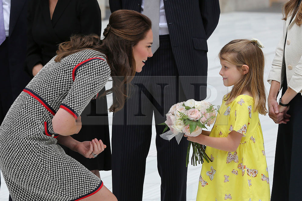 © Licensed to London News Pictures. 29/06/2017. London, UK. 6 years old Lydia Hunt, director's daughter hands the flowers to the Duchess.  The Duchess of Cambridge arrives to tour the V&A Exhibition Road Quarter's new spaces including The Sackler Courtyard, The Blavatnik Hall and The Sainsbury Gallery. Photo credit: Dinendra Haria/LNP