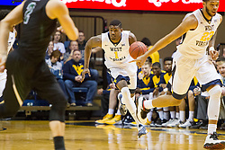 Nov 20, 2015; Morgantown, WV, USA; West Virginia Mountaineers forward Jonathan Holton dribbles the ball up the floor during the first half against the Stetson Hatters at WVU Coliseum. Mandatory Credit: Ben Queen-USA TODAY Sports