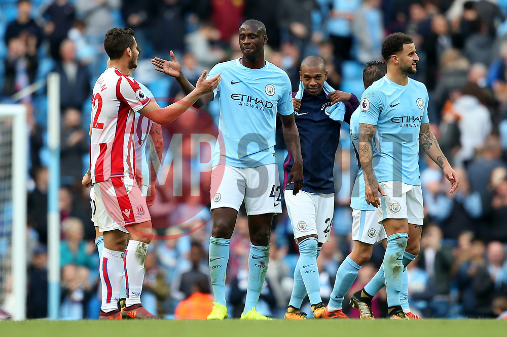 Yaya Toure of Manchester City shakes hands with Ramadan Sobhi of Stoke City at full time - Mandatory by-line: Matt McNulty/JMP - 14/10/2017 - FOOTBALL - Etihad Stadium - Manchester, England - Manchester City v Stoke City - Premier League