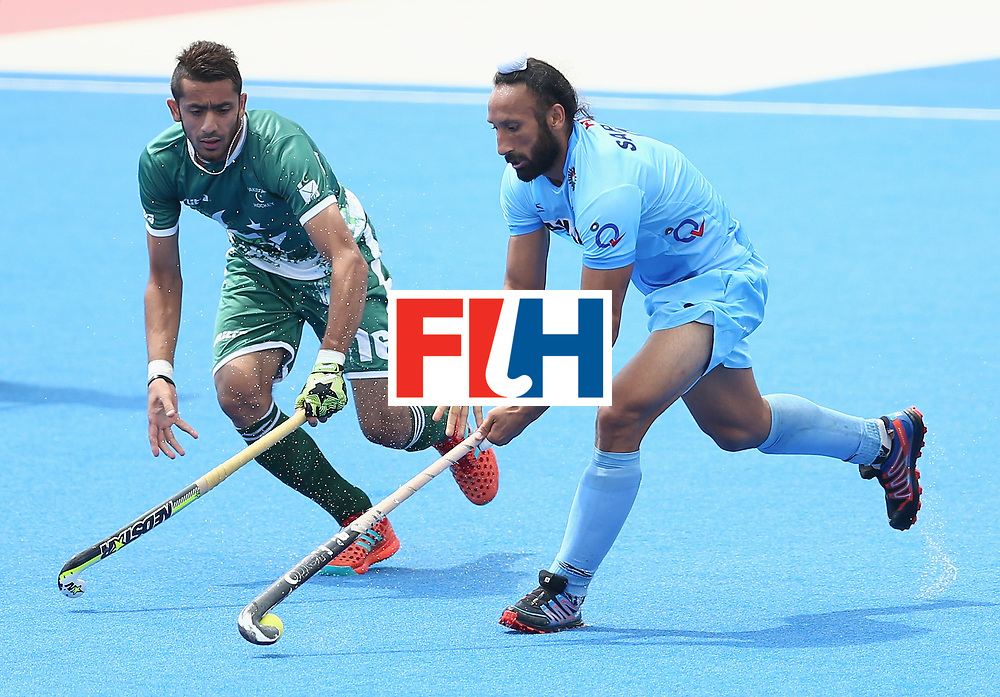 LONDON, ENGLAND - JUNE 24: Ammad Shakeel of Pakistan and Sardar Singh of India battle for possession during the 5th-8th place match between Pakistan and India on day eight of the Hero Hockey World League Semi-Final at Lee Valley Hockey and Tennis Centre on June 24, 2017 in London, England. (Photo by Steve Bardens/Getty Images)