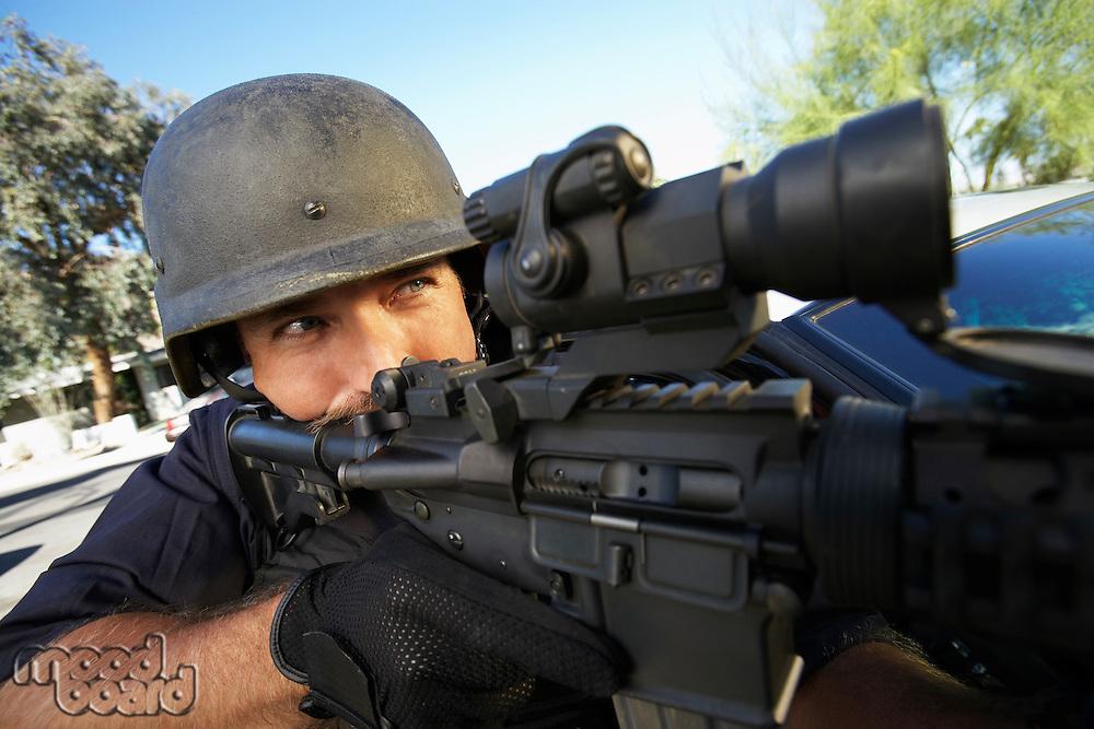 Portrait of Swat officer aiming gun