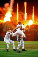 ANAHEIM CA- Troy Percival, Troy Glaus and Benji Molina of the Los Angeles Angels of Anaheim celebrate after defeating the San Francisco Giants to win the 2002 World Series.