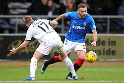 Dundee's Calvin Miller (left) and Rangers' Joe Worrall battle for the ball during the Scottish Premiership match at Dens Park, Dundee.