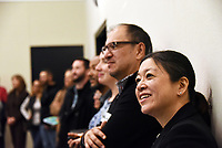 Irene Wong, right, and Miguel Salinas of The David and Lucile Packard Foundation watch the welcome remarks at the December 5th, 2017 opening of the Stories from Salinas exhibition at the CSUMB Salinas Center for Arts and Culture in Oldtown. The exhibition celebrates the mentors, youth and families of the Salinas Youth Initiative.