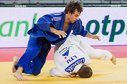 Adrian Gomboc (blue) of Slovenia and Kestutis Vitkauskas of Lithuania compete in the Men's 66kg first round match during day two of the 18th IJF Judo World junior championship  2013, on October 24, 2013 in Arena Stozice, Ljubljana, Slovenia. (Photo by Vid Ponikvar / Sportida)