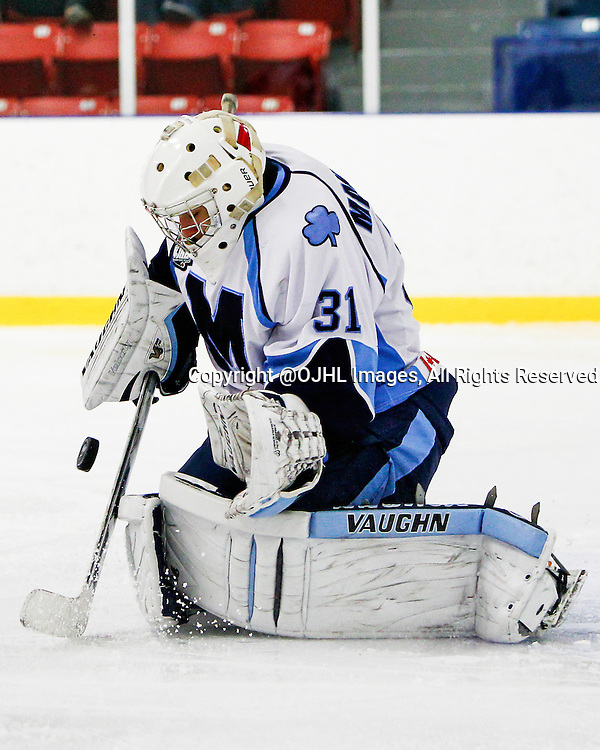 NORTH YORK, ON - Oct 19, 2014 : Ontario Junior Hockey League game action between St. Michaels and North York, Mark Manolescu #31 makes the save during the first period.<br /> (Photo by Brian Watts / OJHL Images)