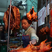 A women prepares duck on a street corner of the old quarter of Hanoi, Vietnam. Hanoi is the capital of Vietnam and the country's second largest city. Hanoi, Vietnam. 17th March 2012. Photo Tim Clayton