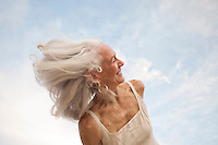 Beautiful seniro woman moving through the sky.