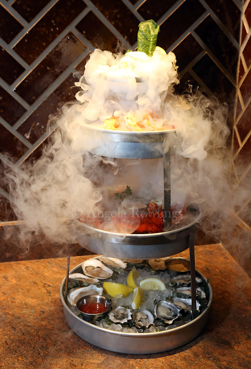 (Boston, NH - 11/30/15) Smoking shellfish tower at Ocean Prime, a new seafood restaurant in the Seaport District, Monday, November 30, 2015. Staff photo by Angela Rowlings.