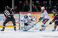 KELOWNA, CANADA -FEBRUARY 5: Jackson Whistle #1 of the Kelowna Rockets defends the net and makes a save on a shot from Evan Polei LW #10 of the Red Deer Rebels on February 5, 2014 at Prospera Place in Kelowna, British Columbia, Canada.   (Photo by Marissa Baecker/Getty Images)  *** Local Caption *** Jackson Whistle; Evan Polei;