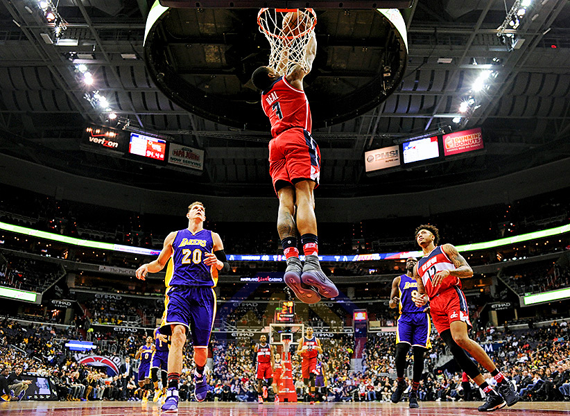 WASHINGTON, DC - FEBRUARY 02: Washington Wizards guard Bradley Beal (3) scores on a reverse dunk in the first half against Los Angeles Lakers center Timofey Mozgov (20) on February 2, 2017, at the Verizon Center in Washington, D.C.  The Washington Wizards defeated the Los Angeles Lakers 116-108. (Photo by Icon Sportswire)