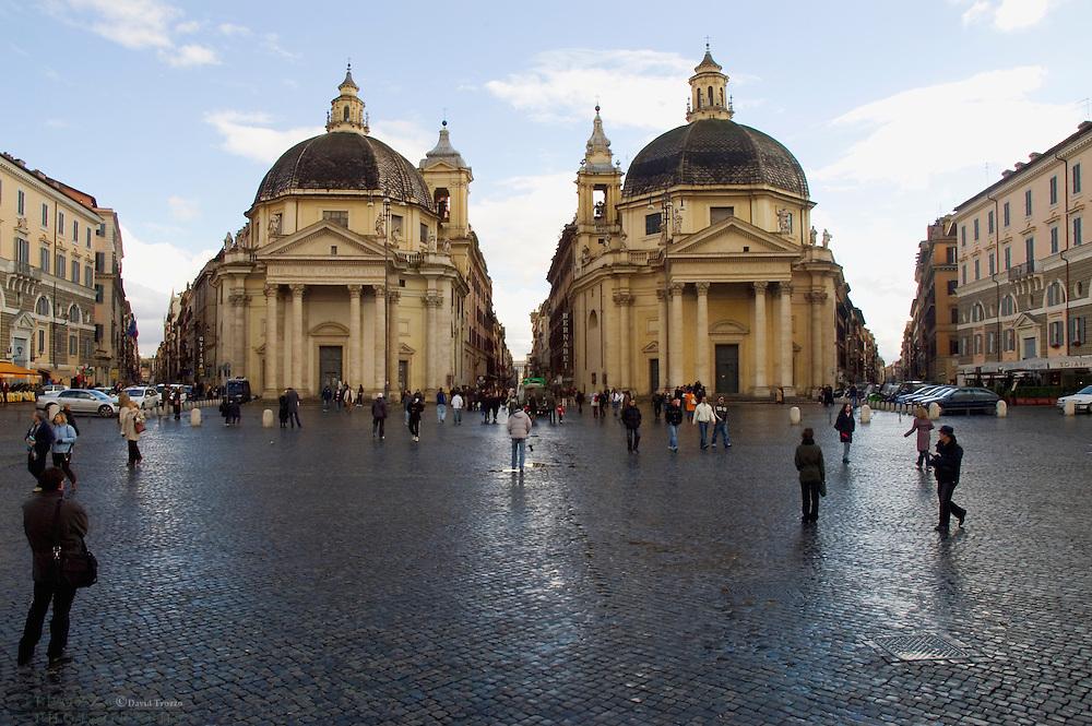 Rome Italy, Pedestrians walk on Piazza del Popolo, in front of the twin Twin churches Santa Maria dei Miracoli, right, and Santa Maria di Montesanto, left.