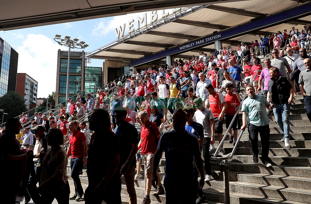 Fans arrive at Wembley Park Station and make their way to the stadium before the Emirates FA Cup Final at Wembley Stadium, London.