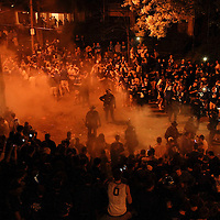 March 31, 2012 - Lexington, Kentucky, USA - Police try to disperse a crowd which was trying to light a fire on State Street as University of Kentucky basketball fans celebrate their team's victory over the University of Louisville in Lexington, Ky., on March 31, 2012. The win for Kentucky advances them to the championship game of the NCAA tournament in New Orleans. Fans took to the streets and in burned couches, turned over a car and ending with a handful of arrests. (Credit image: © David Stephenson/ZUMA Press)