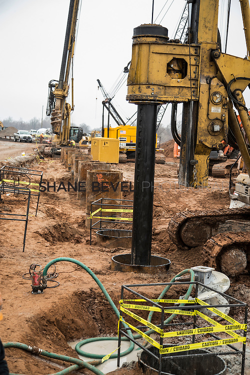 1/21/16 12:17:25 PM --  Construction work at The Gathering Place including setting and pouring the foundation of the lodge, drilling piers along riverside, and dredging the bottom of the pond.  <br /> <br /> Photo by Shane Bevel