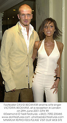 Footballer DAVID BECKHAM and his wife singer VICTORIA BECKHAM, at a reception in London on 29th June 2001.OPX 99