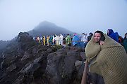Tourists having come to watch sunrise from the top of Haleakala, Maui's giant dormant volcano. However, on this particular day the sun has decided to stay wrapped in clouds.