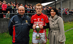 Garrymore U21 captain Trevor Nally accecpting the County U21 trophy from Sinead Stagg Ulster Bank (Sponsor) and Mayo Gaa...Pic Conor McKeown