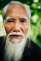 A portrait of an older Vietnamese man in Hanoi, Vietnam.