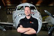 The Life Flight Trust: Portrait of crewman Joseph in front of the air ambulance at Wellington Airport. Thursday 10 July 2014.<br /> <br /> Photo: Mark Tantrum / www.marktantrum.com