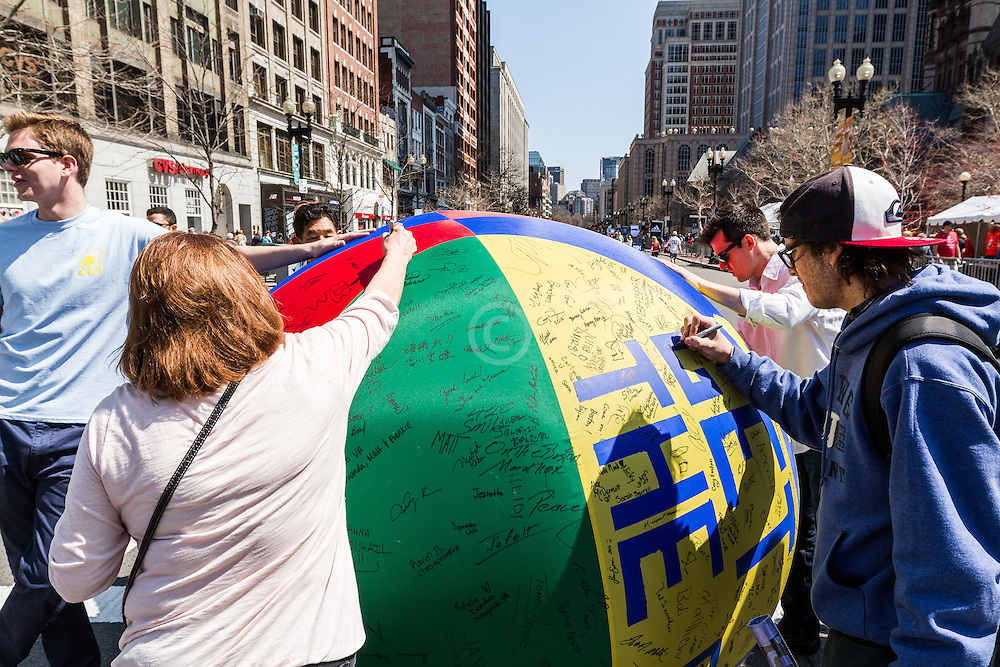 Boston Marathon: fans sign giant beach ball for Children's charity