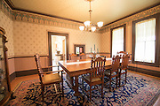 The Historic Hughes house overlooks the Sixes River valley where the river meets the Pacific Ocean near Cape Blanco in Southern Oregon. The 1898 Queen Anne-style house has been turned into an historic house museum and is open to the public.