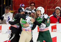 Third placed team of Slovenia: Peter Prevc (L), Jernej Damjan, Jurij Tepes and Robert Kranjec (C) celebrate  during Flying Hill Team at 3rd day of FIS Ski Jumping World Cup Finals Planica 2011, on March 19, 2011, Planica, Slovenia. (Photo by Vid Ponikvar / Sportida)