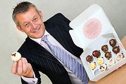 "Atteys Solicitor Steve Taylor with the Atteys ""Sweet Taste Of Scucess"" Cup Cakes..7th September2011 Image © Paul David Drabble"