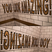 """Restroom in restaurant tiles on wall backwares but corrected by mirror reflection  to spell out """"You Look Amazing!"""""""