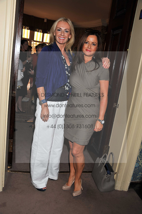 Left to right, JENNY WEISS and HELEN BYGRAVES at a lunch in aid of the charity Kids Company held at Mark's Club, 46 Charles Street, London on 3rd October 2011.
