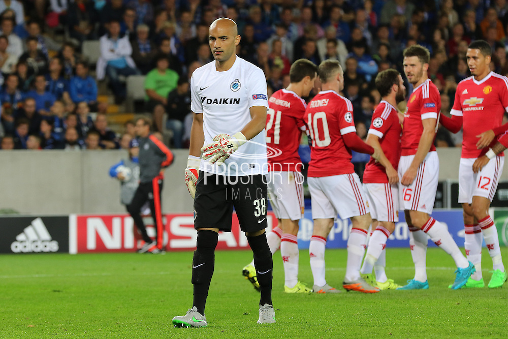 Sinan Bolat of Club Brugge looks on as Wayne Rooney of Manchester United celebrates the third goal during the Champions League Qualifying Play-Off Round match between Club Brugge and Manchester United at the Jan Breydel Stadion, Brugge, Belguim on 26 August 2015. Photo by Phil Duncan.