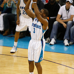 Mar 24, 2010; New Orleans, LA, USA; New Orleans Hornets guard Chris Paul (3) shoots against the Cleveland Cavaliers during the second half at the New Orleans Arena. The Cavaliers defeated the Hornets 105-92. Mandatory Credit: Derick E. Hingle-US PRESSWIRE
