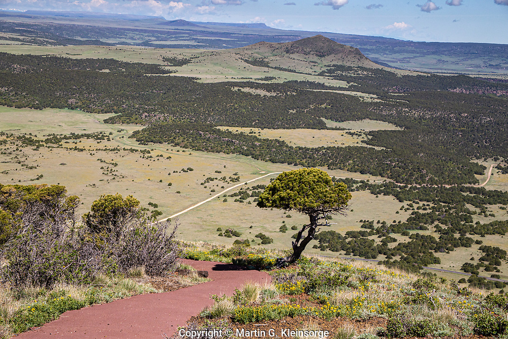 The paved Crater Rim Trail is a one mile long trail that encircles the rim of Capulin Volcano.  Capulin Volcano National Monument, New Mexico.