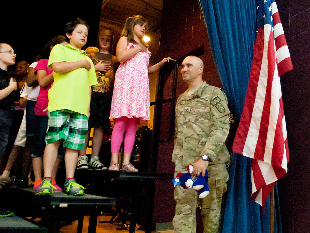 Lathan Goumas | MLive.com..United States Army Staff Sergeant Luis Bratic walks on stage to surprise his 10-year-old son Christopher Bratic during a school assembly at Lillian G. Mason Elementary Scho in Grand Blanc Township, Mich. on Thursday June 7, 2012. Bratic returned home after serving for 11 months in Afghanistan and surprised his son who was not expecting to see him until later in the month.