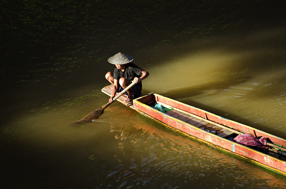 A boat at sunset on the Nam Ou (river), Laos.