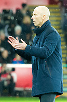 Football - 2016 / 2017 Premier League - Swansea City vs. Stoke City<br /> <br /> Swansea City manager Bob Bradley applauds on the touchline at the end of the game after his team win 2-0—, at The Liberty Stadium.<br /> <br /> COLORSPORT/WINSTON BYNORTH