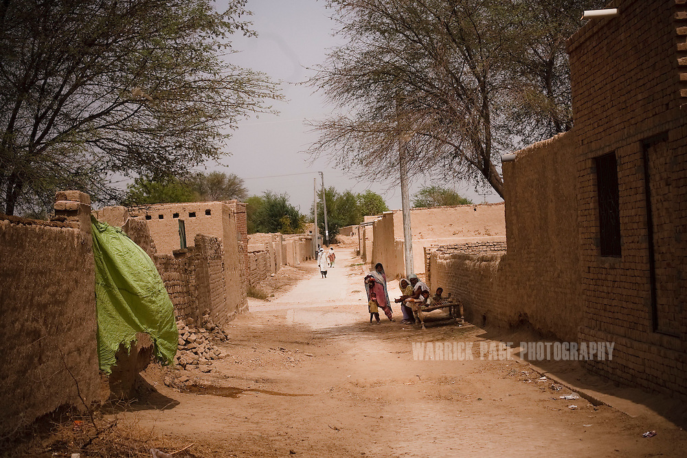 BAHAWALPUR, PAKISTAN - JUNE 18: A village on the outskirts of Bahwalpur where several families are beneficiaries of the Acumen Fund , June 18, in Moosa Colony, Bahawalpur, Pakistan.  (Photo by Warrick Page)