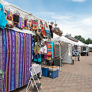 Clothing and textiles stall at the Sunday flea market at Eastern Market, an historic market on Capitol Hill in Washington DC. The original market building was badly damaged by fire in 2007, and the rebuilt building was reopened in 2009.