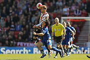 Sunderland midfielder Jan Kirchhoff (27)  beats Leicester City forward Shinji Okazaki (20) to the ball during the Barclays Premier League match between Sunderland and Leicester City at the Stadium Of Light, Sunderland, England on 10 April 2016. Photo by Simon Davies.