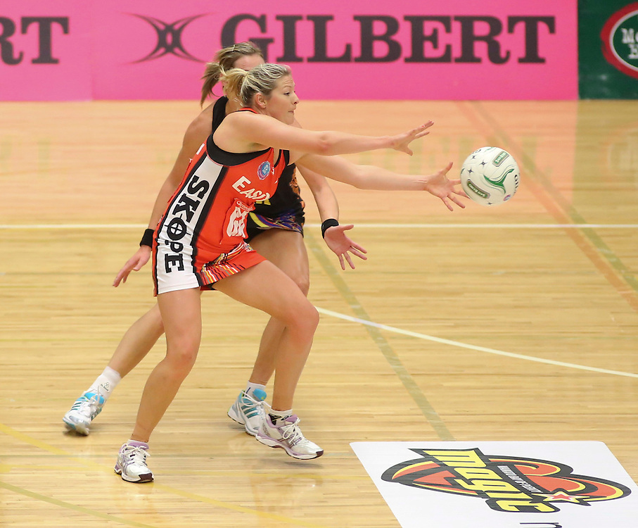The Tactix Anna Thompson takes a pass against the Magic  in the teams ANZ Championship Netball match, Energy Events Centre, Rotorua, New Zealand, Monday, 30 April, 2012. Credit:SNPA / John Cowpland