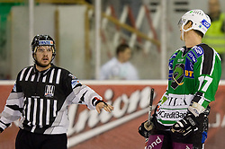 Ziga Pavlin (HDD Tilia Olimpija, #17) talking to lines man during ice-hockey match between HD Tilia Olimpija and HK Acroni Jesenice  in 6th Round of EBEL league, on September 26, 2010 at Hala Tivoli, Ljubljana, Slovenia. (Photo By Matic Klansek Velej / Sportida.com)