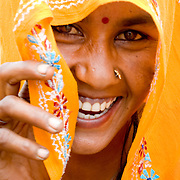 Friendly Jaipur Indian woman in yellow orange saree