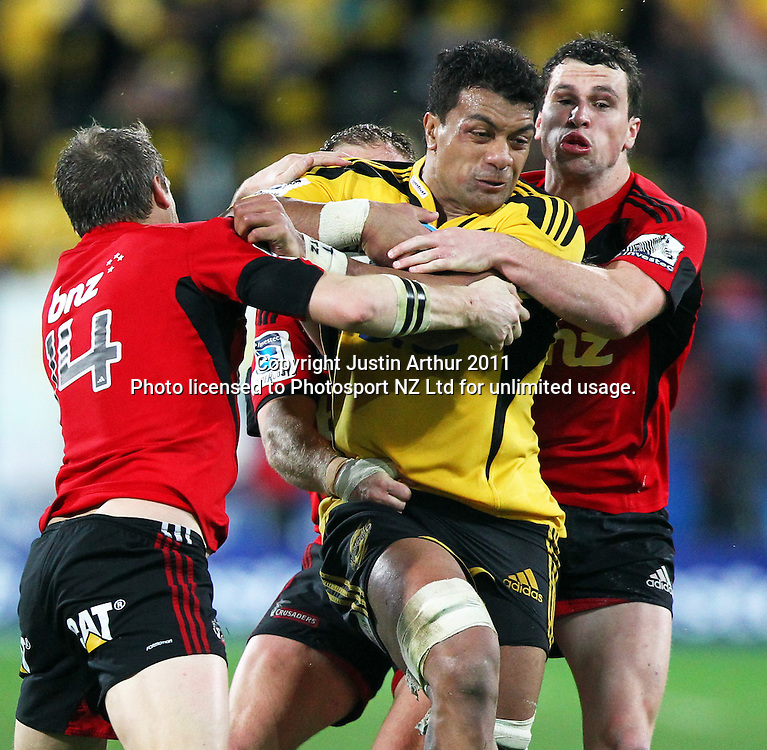 Hurricanes  Faifili Levave gets wrapped up by the Crusaders defense. Super15 rugby union match - Crusaders v Hurricanes at Westpac Stadium, Wellington, New Zealand on Saturday, 18 June 2011. Photo: Justin Arthur / photosport.co.nz