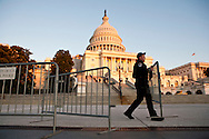 A Capitol Police officer sets up barricades outside the U.S. Capitol in preparation for President Barack Obama's State of the Union address on Tuesday, January 24, 2012 in Washington, DC.