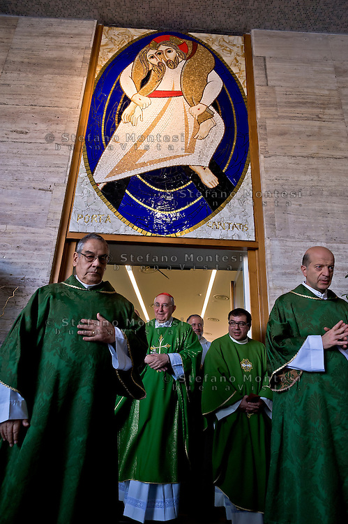 """ROME, ITALY - NOVEMBER 12:  Jubilee, closed Holy Door of Charity at Caritas hostel """"Don Luigi Di Liegro"""". Cardinal Pope's vicar for the Diocese of Rome, Agostino Vallini (C) , has chaired this morning's Mass for the closing of the Holy Door of Charity on November 12, 2016 in Rome, Italy. Open December 18, 2015 by Pope Francis - the first in the history of Jubilees that does not introduce in basilicas, cathedrals and churches,  was crossed by over 12 thousand pilgrims."""