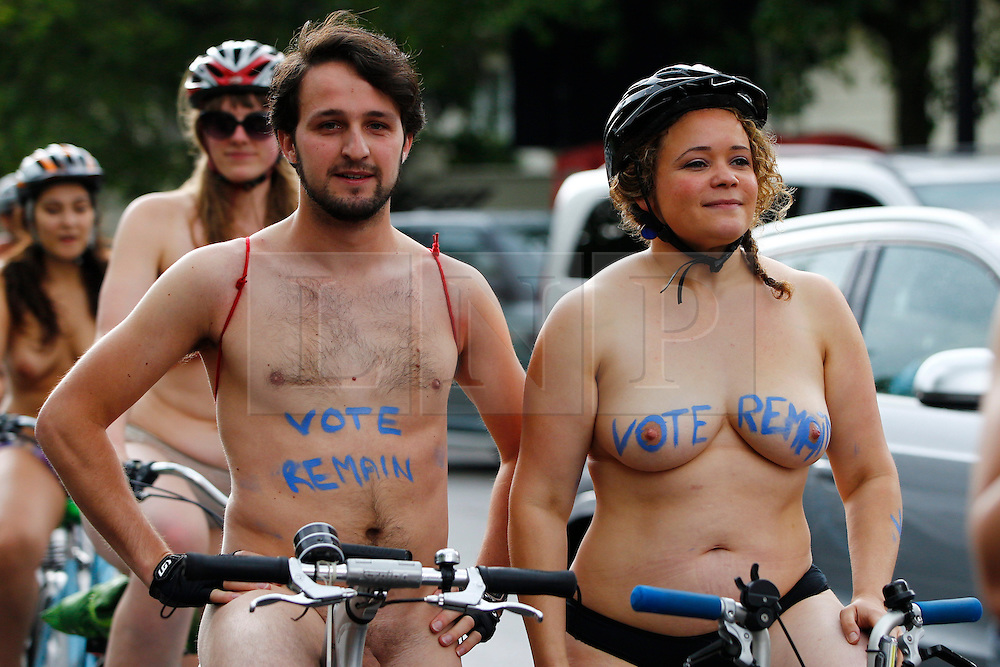 "© Licensed to London News Pictures. 11/06/2016. London, UK. Nude protesters with ""VOTE REMAIN"" written on their bodies take part a naked bike ride in central London on Saturday, 11 June 2016 as part of the World Naked Bike Ride event, which protests against car culture and aims to raise awareness of cyclists on the roads. Photo credit: Tolga Akmen/LNP"
