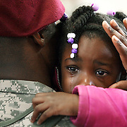 "Brianna Hudson (5) cries as she hugs her father Sergeant Amos Hudson, a member of the 82nd Combat Aviation Brigade, 82nd Airborne Division, returning to Fort Bragg after a year-long deployment in Afghanistan on. The unit provided full-spectrum aviation operations in southern Afghanistan and played a key role under heavy fire in the major assault on Marjah last month. ltqmb ""Welcome Back Dad"""